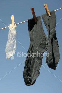 ist2_580840_condom_with_business_socks.jpg